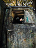 Woman in old truk. Young woman like a driver in old dirty truck Royalty Free Stock Photos