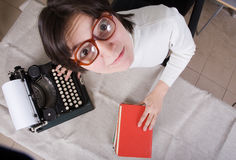 Woman with old typewriter Stock Photography