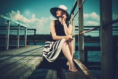 Woman on old wooden pier Royalty Free Stock Images