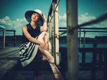 Woman on old wooden pier Royalty Free Stock Photography