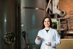 Woman at olive oil factory Royalty Free Stock Photography