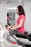 Woman On A Running Simulator Royalty Free Stock Image