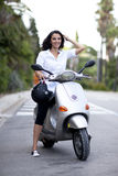 Woman On A Scooter Royalty Free Stock Photos