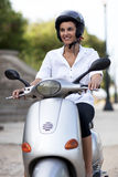 Woman On A Scooter Royalty Free Stock Photo