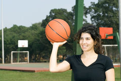 Woman On Basketball Court Holding Basketball Royalty Free Stock Images