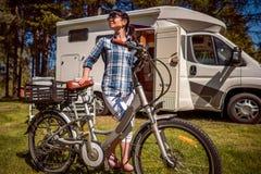 Free Woman On Electric Bike Resting At The Campsite VR Caravan Car Va Stock Photo - 126312350