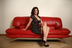 Free Woman On Red Couch Stock Photos - 7852763