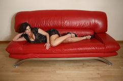 Free Woman On Red Couch Stock Photo - 7852770