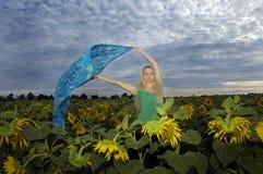 Woman On Sunflowers Field