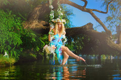 Free Woman On Swing Over River Royalty Free Stock Photo - 76151755