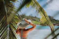 Free Woman On The Beach In The Palm Trees Shadow Wearing Blue Hat. Luxury Paradise Recreation Vacation Concept Stock Photo - 150655490
