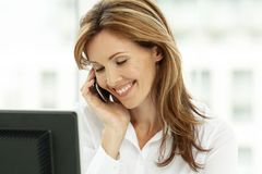 Free Woman On The Phone - Businesswoman Using Phone In Office - Corporate Executive Stock Image - 142535041