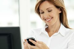 Free Woman On The Phone - Businesswoman Using Phone In Office - Corporate Executive Stock Image - 142535251