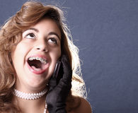 Woman On The Phone Laughing Royalty Free Stock Images