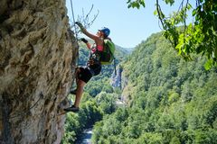 Free Woman On Via Ferrata At Suncuius, Bihor County, Romania, On A Bright Sunny Day, With Crisul Repede Defile Below Her Stock Photo - 160585670
