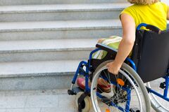 Free Woman On Wheelchair And Stairs Stock Images - 169169534