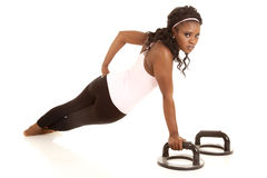 Woman one arm pushup back Stock Images