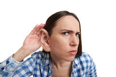 Woman with one big ear listening Stock Photos