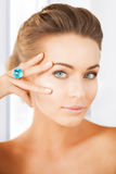 Woman with one jewelry ring Stock Photos