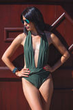 Woman in one-piece swimsuit Royalty Free Stock Photography