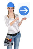 Woman with a one way sign Royalty Free Stock Image