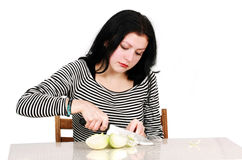 Woman with onion. Woman cutting onion in the Kitchen stock photos