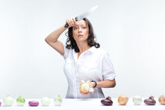 Woman with onions Stock Images