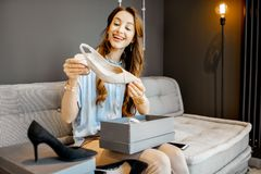 Woman with online puchases at home stock photo
