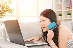 Woman online shopping through credit card Stock Photos