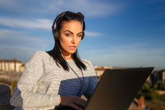 Woman online shopping by laptop outdoor Royalty Free Stock Images