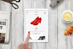 Woman online shopping red shoes with tablet Royalty Free Stock Image