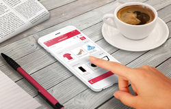Woman online shopping with smart phone on wooden table Stock Photos