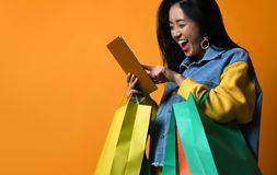 Woman online shopping though tablet pc stock image