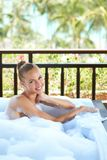 Woman in open-air bubble bath Stock Photo