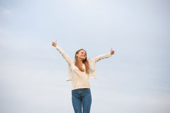 Woman with open arms in the sky background at the morning.  Royalty Free Stock Photos