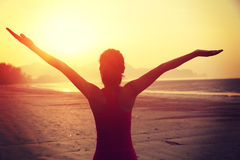 Woman open arms on sunrise  beach Royalty Free Stock Images