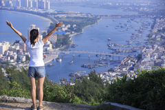 Woman open arms. Woman arms to beautiful sea bay landscape Royalty Free Stock Image