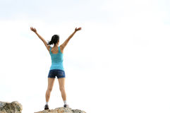Woman open arms to sky Stock Photo