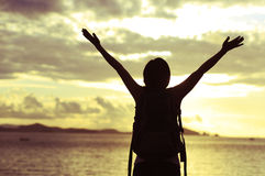 Woman open arms to sunrise Royalty Free Stock Photo