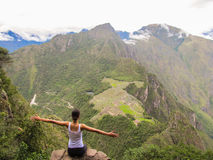 Woman with open arms at the top of Wayna Picchu mountain in Machu Picchu. Woman at the top of Wayna Picchu mountain in Machu Picchu, Peru stock image