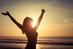 Woman open arms under the sunset Stock Images