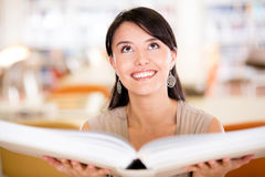 Woman with an open book Stock Photography