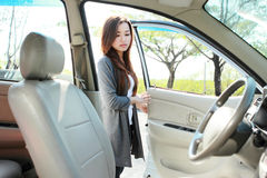 Woman open the car door Royalty Free Stock Photography