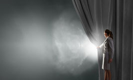 Woman open curtain Royalty Free Stock Photo