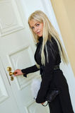Woman open door. Beautiful blond woman open door Stock Image
