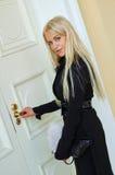 Woman open door Stock Image