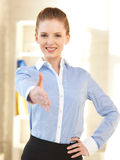 Woman with an open hand ready for handshake Stock Images
