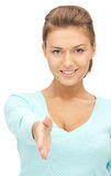Woman with an open hand ready for handshake Stock Image