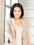 Woman with an open hand ready for handshake Royalty Free Stock Image