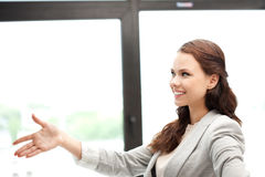 Woman with an open hand ready for handshake Stock Photo